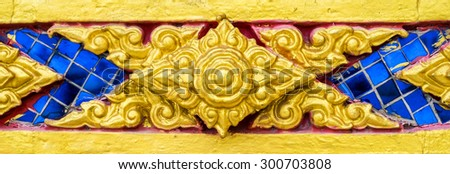 Pattern blue gold of thai traditional ornament paint on temple door wall - stock photo