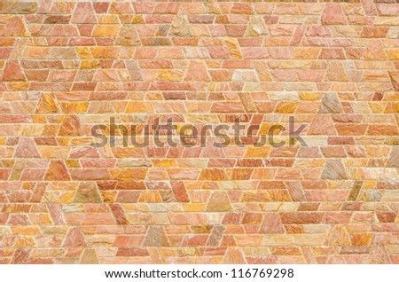 pattern color of modern style  design decorative  red slate stone wall surface with cement in trapezoid shape - stock photo
