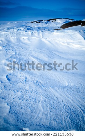 Pattern in the snow made of the wind - stock photo