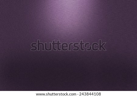 Pattern of brushed purple metal background. Subdued light is in the upper middle part of the background. - stock photo