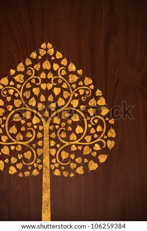 Pattern of carve gold tree on old wood texture