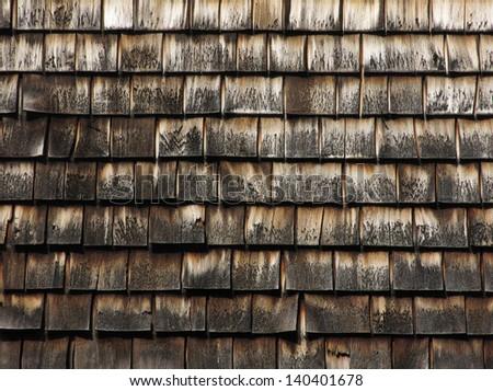 Pattern of cedar shingles on old Cape Cod building - stock photo