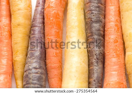 pattern of colorful carrots on white board, close up, top view, horizontal - stock photo
