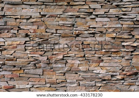 pattern of decorative brown grey slate stone wall surface, background, texture - stock photo