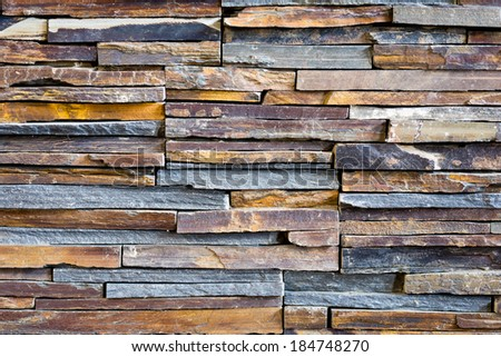 Pattern of decorative slate stone wall background - stock photo