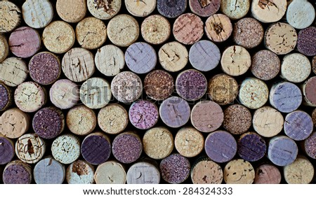 Pattern of different used wine corks background.