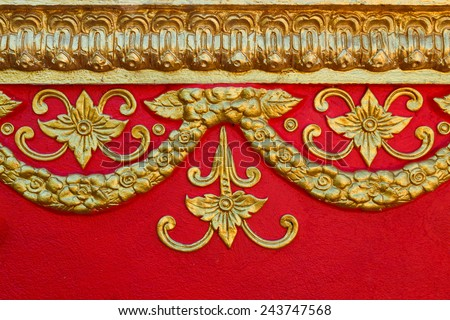 Pattern of flower carved on cement wall background. - stock photo