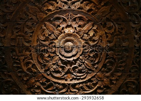 Pattern of flower carved on wood background. - stock photo