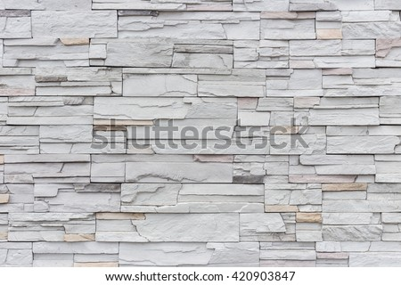 Pattern of grey and rough sandstone wall texture and background