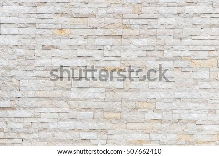 Pattern of grey and rough sandstone wall texture for background