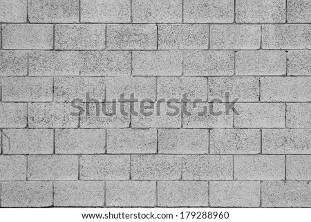 Pattern of grey wall made of concrete bricks - stock photo