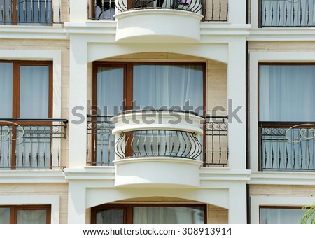Pattern of hotel room balconies in modern building - stock photo