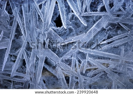 pattern of ice crystals on frozen lake - stock photo
