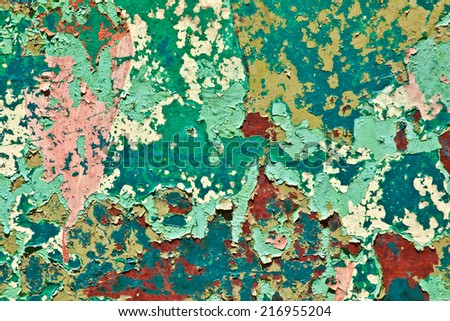 Pattern of old painted metal surface. Rusty metal, peeling paint, green, red and yellow tones, bright colors. - stock photo