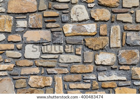 Pattern of old stone wall surfaced texture - stock photo