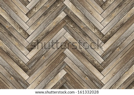 pattern of old wood tiles forming parquet floor - stock photo