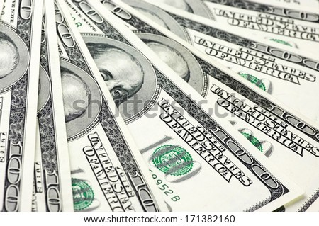 Pattern of one hundred dollar bills. - stock photo