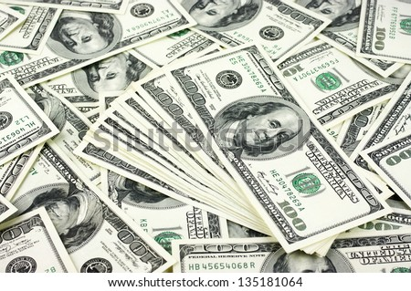 Pattern of one hundred dollar bills pile. - stock photo