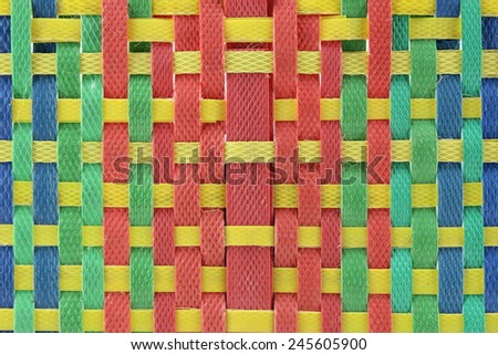 pattern of polypropylene woven multicolor combinations - stock photo