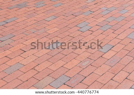 Pattern of red and grey brick tile background.