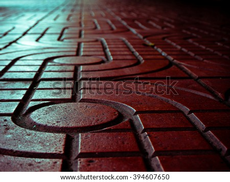 Pattern of sidewalk. Red pattern street road. Sidewalk, pavement texture. Blue green light reflection. - stock photo