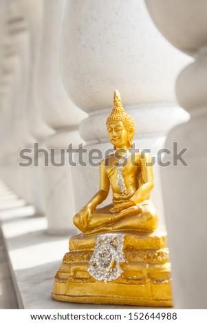 pattern of White pillar with golden Buddha - stock photo