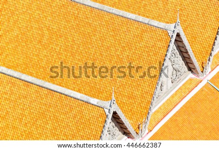 Pattern of yellow ceramic roof tiles