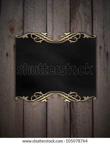 Pattern on a Black plate on a wood background