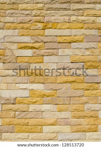 pattern vintage color of modern style design decorative uneven cracked real stone wall surface with cement - stock photo