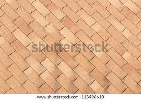 Patterned brick floor with several layers of redundancy.