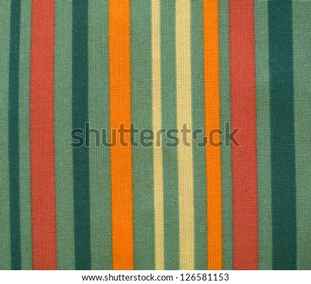Patterned fabric in red, orange, green and white
