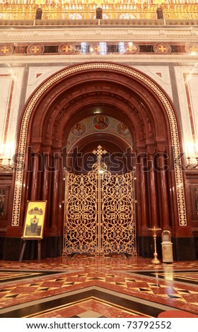 Patterned gilt door in arch inside Cathedral of Christ the Saviour in Moscow, Russia - stock photo