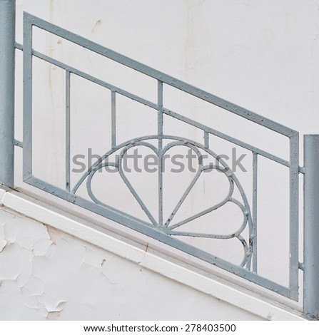 Patterned old railing on the stairs street - stock photo