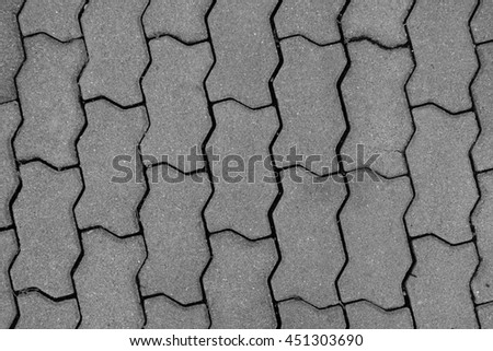 Patterned paving tiles, cement brick floor ground - stock photo