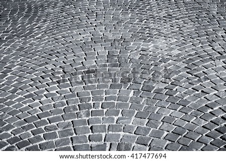 patterned paving tiles cobblestone road for texture - stock photo