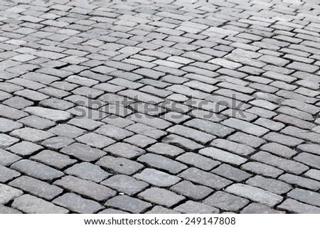 patterned paving tiles of olf sreet square - stock photo