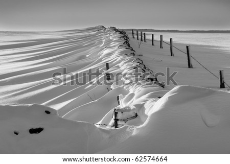 Patterns made by drifting snow in landscape - stock photo