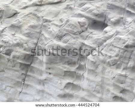 Patterns on a grey rock - stock photo