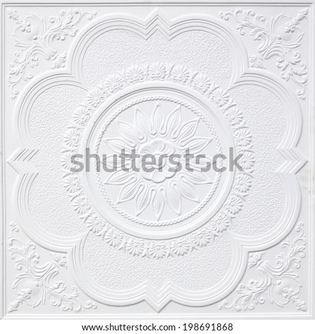 Patterns on the ceiling gypsum sheets of white flowers. - stock photo