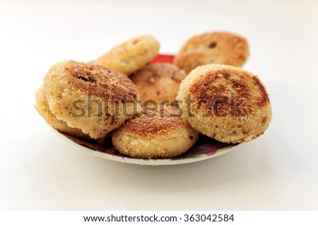 Patties of mashed potatoes on the plate - side view