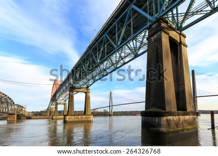 Pattullo Bridge across over Fraser River, British Columbia, Canada  - stock photo