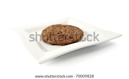 patty on a white plate on white background - stock photo