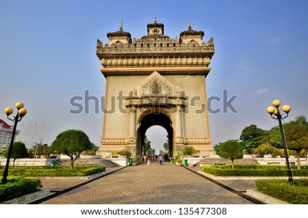 Patuxai literally meaning Victory Gate or Gate of Triumph, formerly the Anousavary or Anosavari Monument, known by the French as (Monument Aux Morts) is a war monument in the centre of Vientiane, Laos - stock photo
