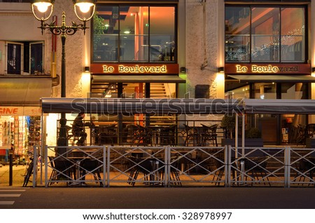 PAU, FRANCE - JANUARY 02 2015: The alone visitor drinks the early coffee in the outdoor terrace of the boulevard of Pyrenees in the French city PAU, FRANCE - JANUARY 02 2015.
