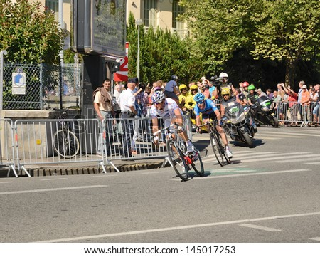 "PAU, FRANCE - JULY 16 : Participants of the 99th cycle race ""Tour de France"" Pierrick Fedrigo and Hesjedal Ryder lead in the street of PAU, FRANCE on the 16th JULY 2012."