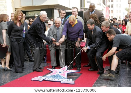 Paula Abdul and Magic Johnson Honoring Ceremony of  Los Angeles Lakers Owner,  Jerry Buss as the 2,323rd star on the Hollywood Walk of Fame, Hollywood, California, October 30, 2006. - stock photo