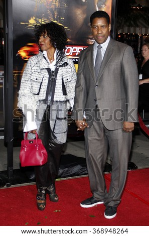 "Pauletta Washington and Denzel Washington at the Los Angeles Premiere of ""Unstoppable"" held at the Westwood Village Theater in Hollywood, California, United States on October 26, 2010.  - stock photo"