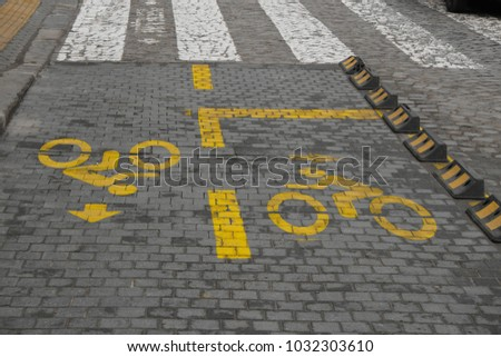 Paved bike hall in front of a pedestrian walkway with symbols for cyclists in the center of Sofia, Bulgaria - one of the capitals of EU countries with the least developed cycling infrastructure