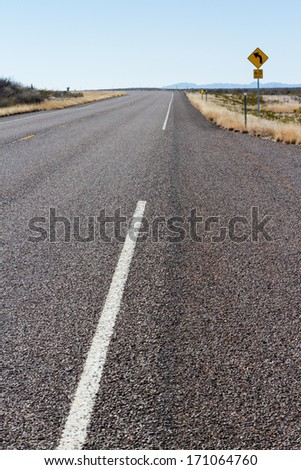 Paved empty road in the desert. - stock photo