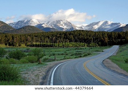 paved road leading to mountains, Colorado